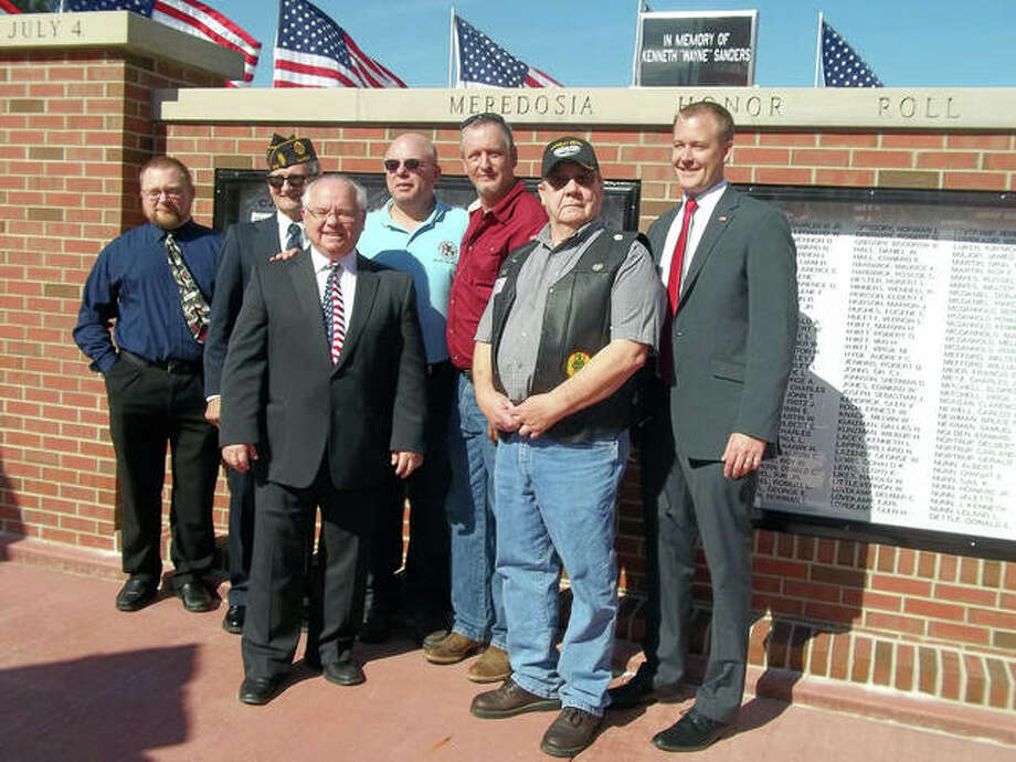 "Meredosia board member Kenneth Scott, Mount Sterling American Legion Post 374 chief David Newell, the Rev. Kenneth Sanders, Senator William ""Sam"" McCann, Meredosia Mayor David Werries, Meredosia American Legion Post 516 member Ernie Gregory and state Rep. C.D. Davidsmeyer were among those honoring veterans at a dedication in Meredosia. Photo: Shirley Bilyeu 