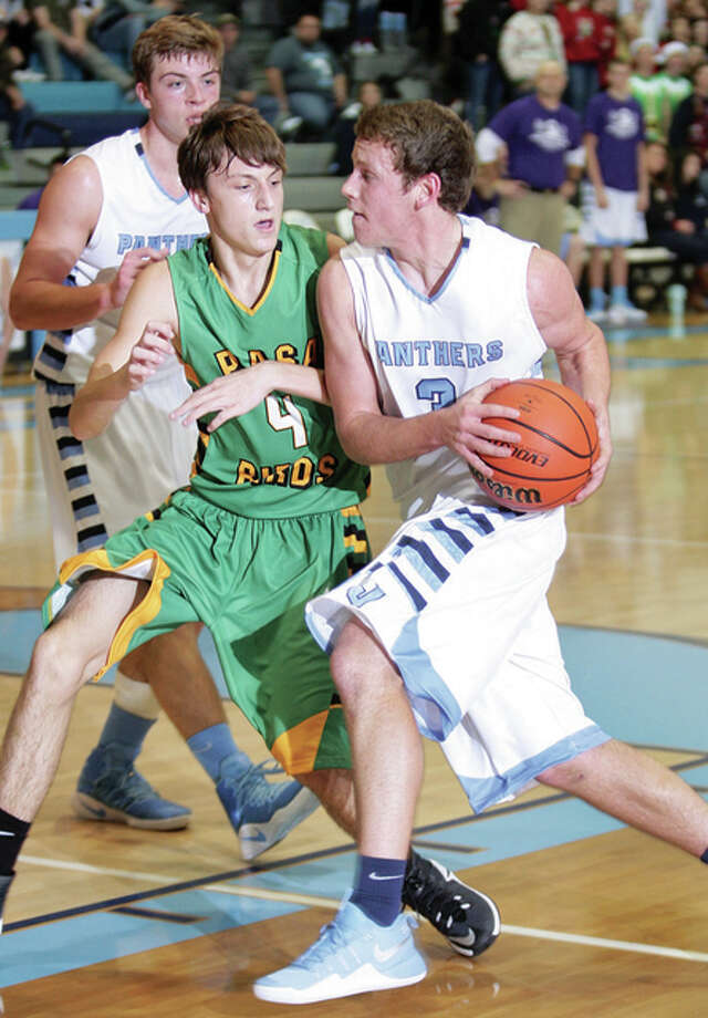 Jersey's Kurt Hall, right, scored 15 points in the Panthers' loss to Cahokia Friday in the Jersey Mid-Winter Classic at Haven Gym. Teammate Jake Ridenhour also scored 15 for the Panthers. Hall is shown in action earlier against Southwestern. Photo: Telegraph File Photo