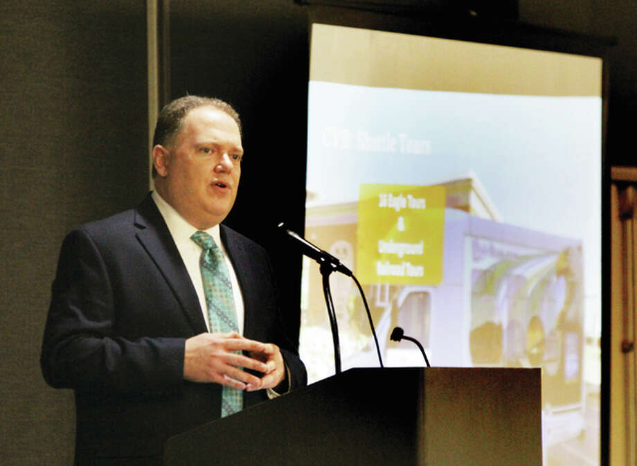 "Brett Stawar, president and CEO of the Alton Regional Convention and Visitor's Bureau, speaks at a ""Tourism Summit"" by the CVB Thursday at the Atrium Hotel and Conference Center in Alton."