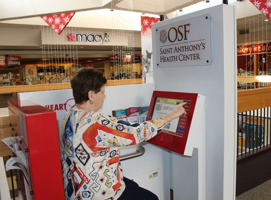 Marti Keller of Alton uses the OSF Saint Anthony's Heart Check Station at the Alton Square Mall.