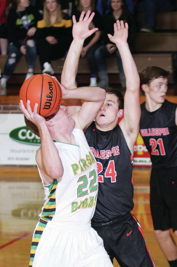 Southwestern's Ben Lowis looks to shoot over Gillespie's Anthony Kravanya during pool play at the 99th annual Macoupin County Tournament in Carlinville. Photo: James B. Ritter   For The Telegraph