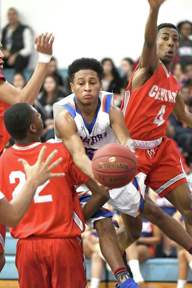 Danbury's Javon Hernandez makes a pass between Central's Ra'Quan Rilley, left, and Zack William, during the FCIAC boys basketball game between Danbury and Bridgeport Central in Danbury, Feb. 9, 2018. Photo: Krista Benson / The News-Times Freelance