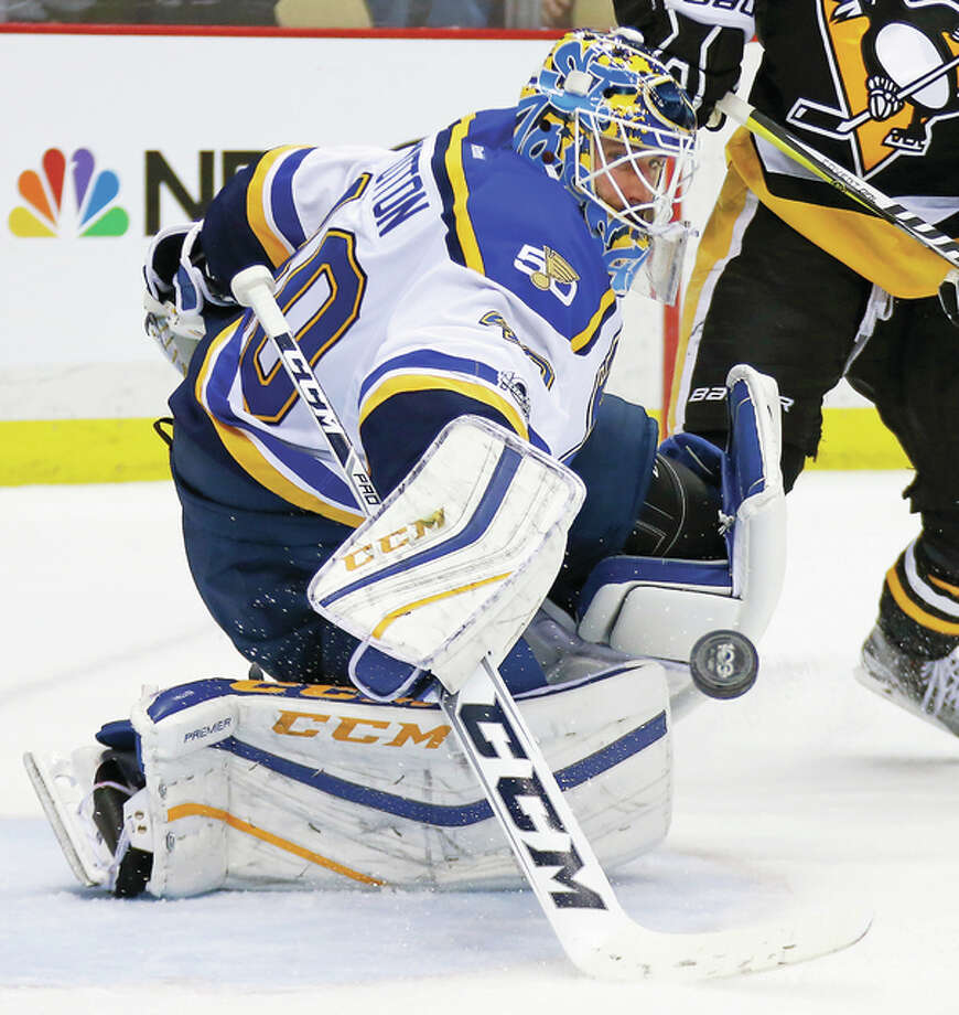 Blues goalie Carter Hutton blocks a shot during the second period Tuesday night against the Penguins in Pittsburgh. Photo: AP