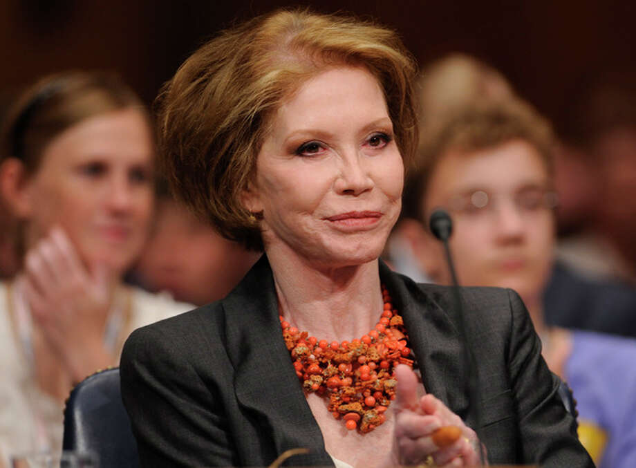 FILE - This June 24, 2009 file photo shows actress Mary Tyler Moore before the Senate Homeland Security and Governmental Affairs Committee hearing on Type 1 Diabetes Research on Capitol Hill in Washington. Moore died Wednesday, Jan. 25, 2017, at age 80.