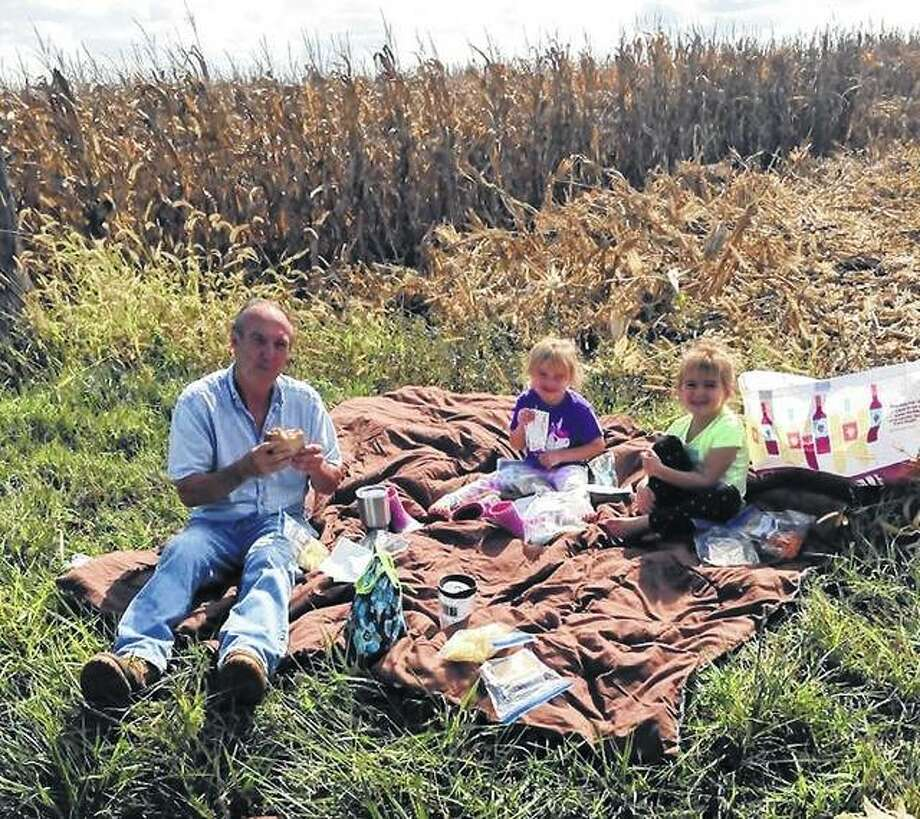 Grandfather Everett Johnson enjoys an autumn picnic with granddaughters Miley and Maddy Klendworth on a farm near Franklin. Photo: LeAnn Johnson | Reader Photo