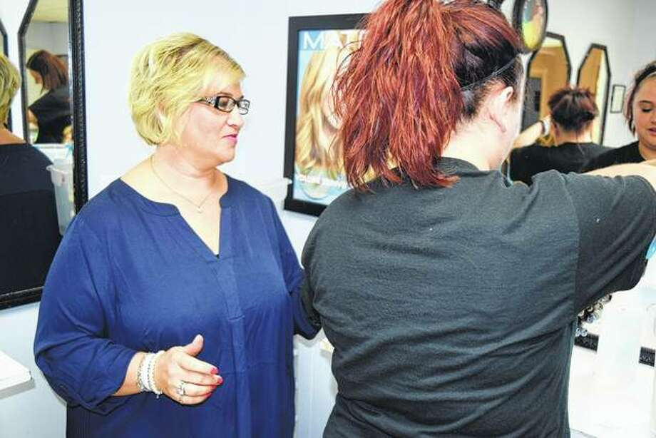 Amy Smith, administrator of operations at Mr. John's School of Cosmetology and Nails, instructs student Katelyn Lummis on Wednesday. Photo: Nick Draper   Journal-Courier