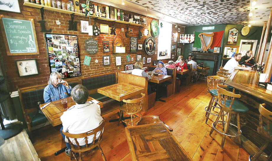 A group of customers enjoy a quiet lunch Wednesday inside the cozy space of Morrison's Irish Pub at the foot of State Street in Alton near the Ardent Mills complex. The restaurant is one of almost two dozen particpating in Restaurant Week, which ends Sunday.