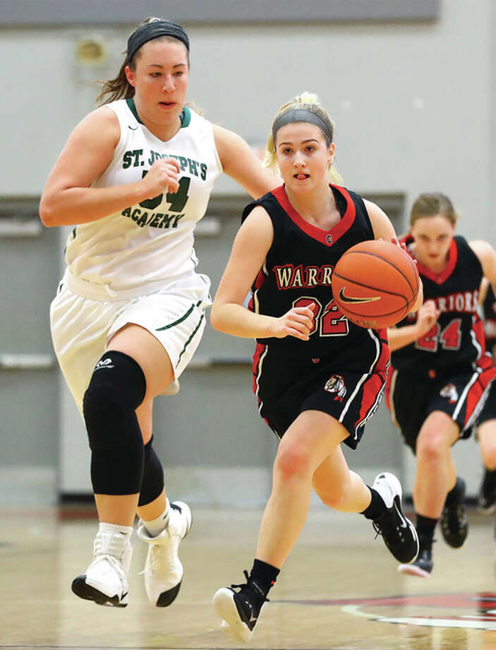 Calhoun's Sophie Lorton (right) pushes the ball upcourt while St. Joseph's Academy's Kelly McLaughlin tries to keep pace during the Alton Shootout on Jan. 16 at Alton High. Lorton and the Warriors took on another large school in Civic Memorial on Thursday night in the semifinals of the Carrollton Tournament. Photo: Billy Hurst / For The Telegraph