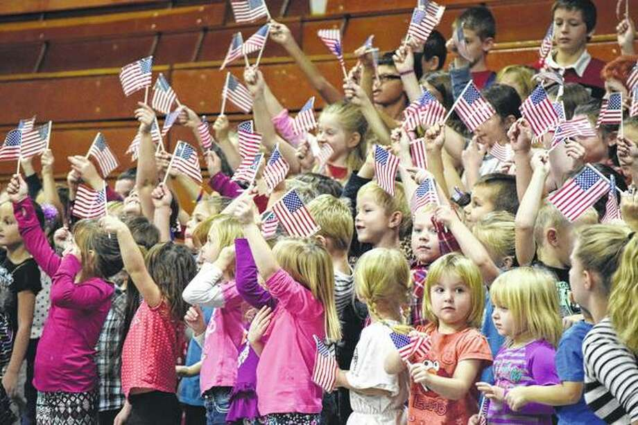 Pre-kindergartners through fourth-graders honor veterans through song during a Veterans Day program Friday at Meredosia-Chambersburg High School. Photo: Nick Draper | Journal-Courier