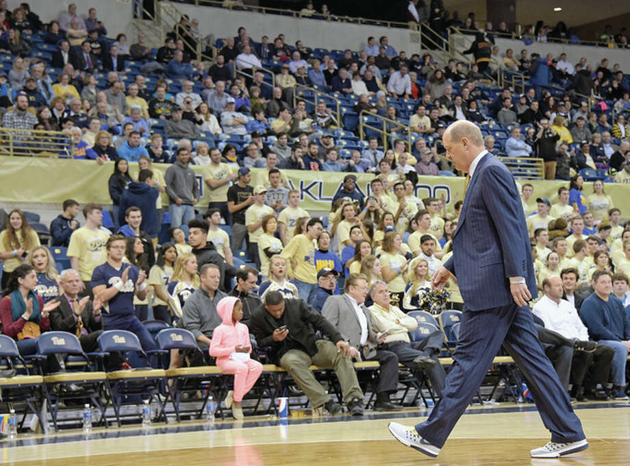 Pitt head coach Kevin Stallings walks off the court after being ejected during the second half of Tuesday's game against Louisville in Pittsburgh. Stallings is a native of Meadowbrook and was a prep all-stater at Collinsville in the late 1970s.
