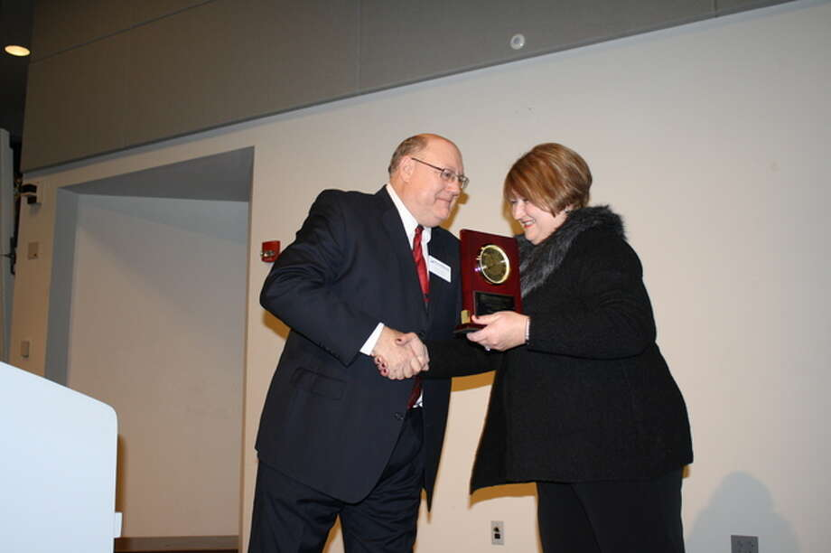 Outgoing RBGA Board Chairman Karen Wilson accepts a gift from incoming Chairman Augie Wuellner.