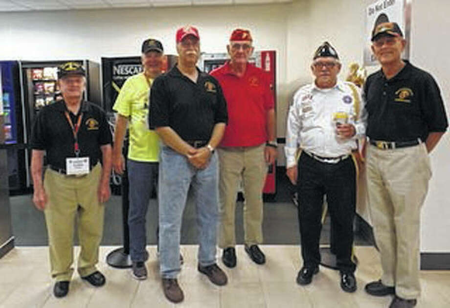 A group of Marines from the Jacksonville Marine Corps League recently helped with the last Honor Flight of the year. They included Jerry Lowe (from left), who was on Iwo Jima in World War 2; Jim Carleton, Tim Ritzo, Earl Turner, Dave Beatty of Springfield and Bob Komnick. Photo: Photo Provided