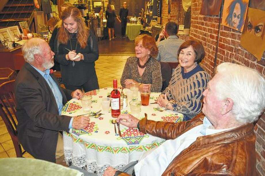 Jacksonville High School senior and Interact Club treasurer Nora Homolka (standing) takes dinner orders from Don English (from left), Judy Nelson, Kathy English and Dick Nelson on Saturday night at Fork & Knife — Change a Life, the Interact Club's benefit dinner for hurricane relief at Soap Co. Coffee House on the downtown Jacksonville square. Photo: Greg Olson | Journal-Courier