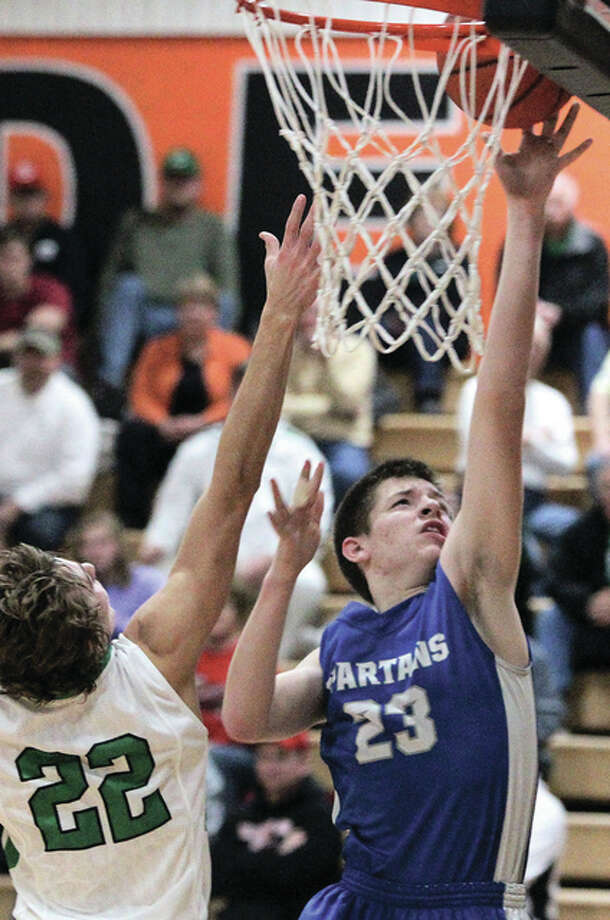 North Greene's Jonah Hopper (23) sinks a layup after getting past Carrollton's Lance Schelt during a key stretch in the third quarter Friday night at the Beardstown Tournament. Photo: Dennis Mathes, Journal-Courier | For The Telegraph