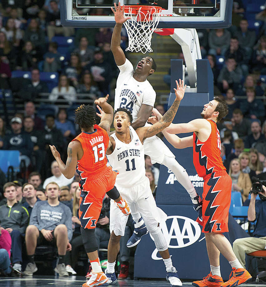 Penn State forward Mike Watkins, top and forward Lamar Stevens attempt to block Illinois guard Tracy Abrams from shooting the ball Saturday in State College, Pa.