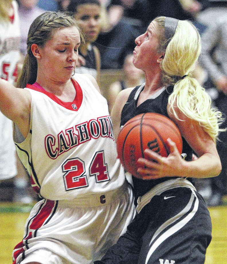 Winchester West Central's Sydney Rock (right) drives against Calhoun's Emily Baalman on Saturday night in the third-place game of the Carrollton Tournament. Photo: Dennis Mathes, Journal-Courier | For The Telegraph