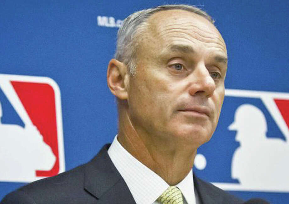 Baseball Commissioner Rob Manfred Monday announced that the Cardinals must forfeit their top two picks in this year's amateur draft and pay the Houston Astros $2 million as compensation for hacking the Astros email system and scouting database. Photo: File Photo