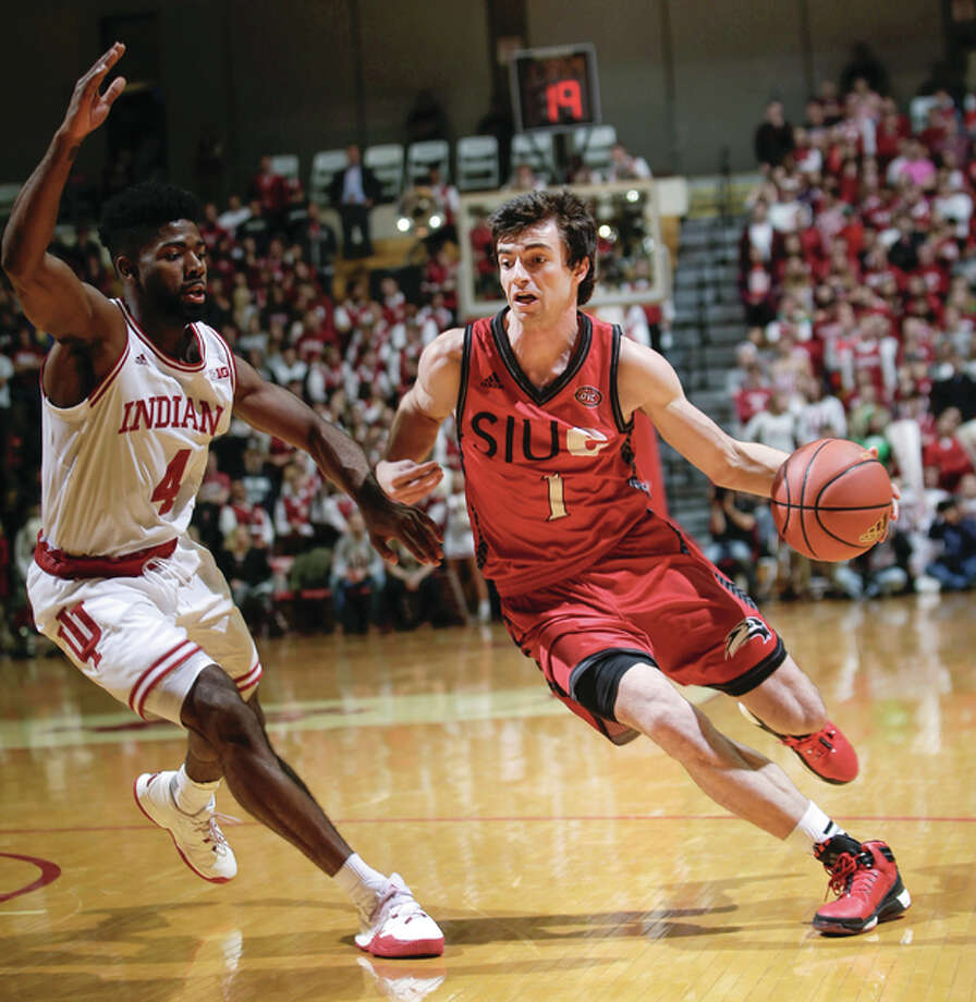 SIUE senior Burak Eslik (right) scored 18 points in his team's 92-69 loss to Belmont Monday night in Nashville, Tenn. A former Lewis and Clark Community College Trailblazer, Eslik is shown in earlier action at Indiana. Photo: AP File Photo