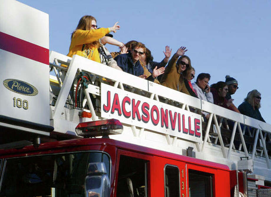 Members of the Illinois School for the Visually Impaired girls' goalball team and their coaches ride on a Jacksonville Fire Department ladder truck Wednesday to celebrate winning the North Central Association of Schools for the Blind Conference championship Saturday in St. Louis. The team rode around downtown Jacksonville and back to the school, where a pep rally was held in the team's honor. It was the first time since 2010 that the girls' goalball team had won the conference title. The ISVI boys' goalball team captured second place in the conference this year.
