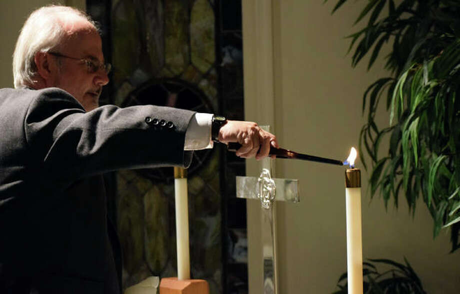 Pastor Robin Lyons lights a candle for a special prayer service in honor of the victims of the Sutherland Springs, Texas church mass shooting Wednesday night at the Winchester United Methodist Church . Photo: Samantha McDaniel-Ogletree | Journal-Courier