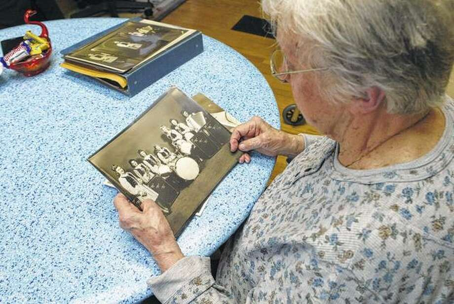Helen Krol of Jacksonville looks at a picture of Helen's Polka Dots, an all-female band she formed in Chelsea, Massachusetts, a Boston suburb, during World War II.