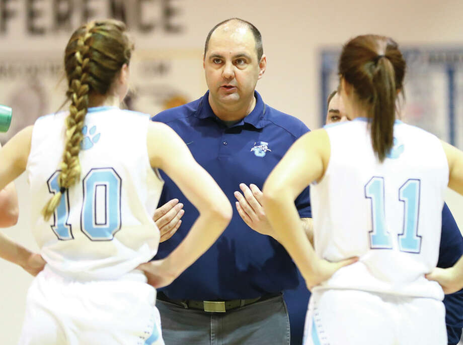 Jersey coach Kevin Strebel talks with Mackenzie Thurston (left) and Ashleigh Trochuck during Dec. 27 game in the Jersey Tourney. The Panthers beat Mascoutah on Tuesday night to clinch a winning season for the first time in five years. Photo: Billy Hurst / Telegraph File Photo