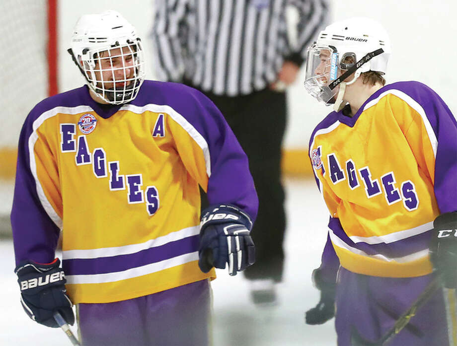 Bethalto's Anthony Russo, right, is congratulated by Jayden Kahl after scoring a goal earlier this season against EA-WR. Bethalto will begin Class 2A playoff action against O'Fallon Thursday in Game One of their best-of-three series at the East Alton Ice Arena. Photo: Billy Hurst File Photo | For The Telegraph