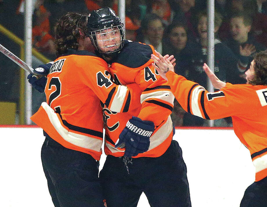 Edwardsville's Tyler Schaeffer, center, celebrates with teammates after a playoff goal last season. EHS learned Tuesday that it has received a second consecutive berth at the USA National High School Tournament in Cleveland in March. Schaeffer, who leads EHS this season with 16 goals and 17 assists, will lead the Tigers into the Mid-States Hockey League playoffs this weekend. Photo: Billy Hurst File Photo | For The Telegraph