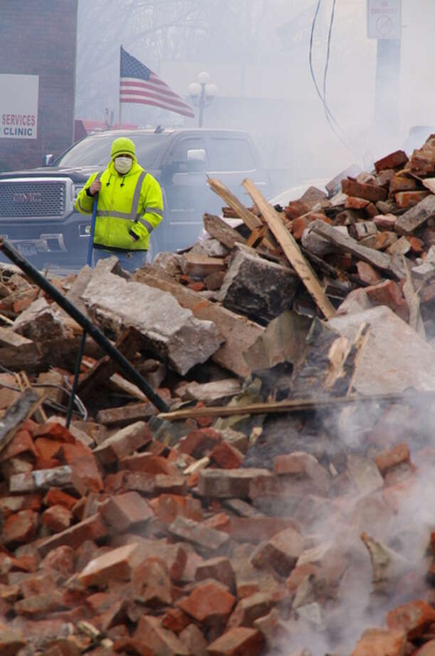 City crews survey the debris pile from Tuesday's downtown White Hall fire. Photo: David Blanchette | For The Telegraph