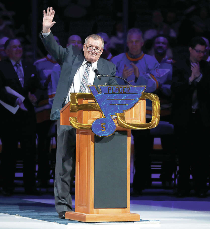 Former St. Louis Blues great Bob Plager waves to fans while speaking during a ceremony to retire his number prior to Thursday night's game between the Blues and the Toronto Maple Leafs in St. Louis. Photo: Jeff Roberson | AP