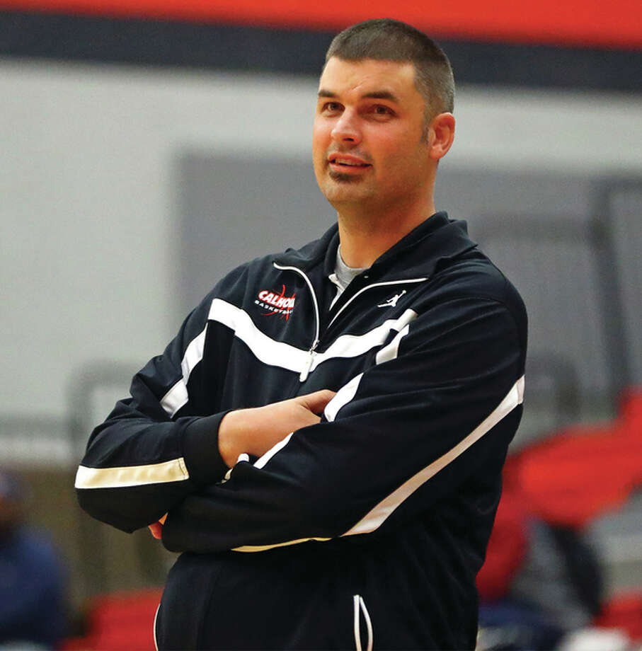 Calhoun coach Aaron Baalman, shown watching his team during a game at the Alton Tournament on Nov. 16, earned career win No. 200 Thursday night in Winchester. The Warriors beat West Central 67-65 in overtime to put Baalman at 200-48 in seven seasons at Calhoun. Photo: Billy Hurst / Telegraph File Photo