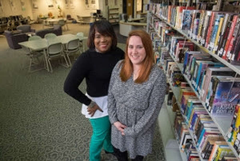 Lara Jennings, director of the SIUE East St. Louis Library Learning Resource Center, with Vera Jones, parent specialist, who coordinates programs connecting parents to educational and employment resources at the LRC and at Vivian Adams Early Childhood Center.
