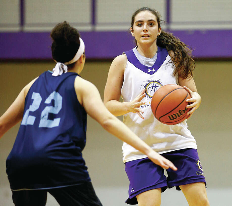 CM's Kaylee Eaton, right, hit a pair of 3-pointers to break Katie Broadway's school single-season record for 3-pointers (66) Thursday night in CM's 56-32 victory over the Triad Knights in a Mississippi Valley Conference game in Bethalto. Eaton has 69 treys. Photo: Telegraph File Photo