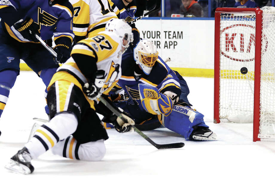Pittsburgh's Sidney Crosby (87) scores past Blues goalie Jake Allen during the first period Saturday night in St. Louis.