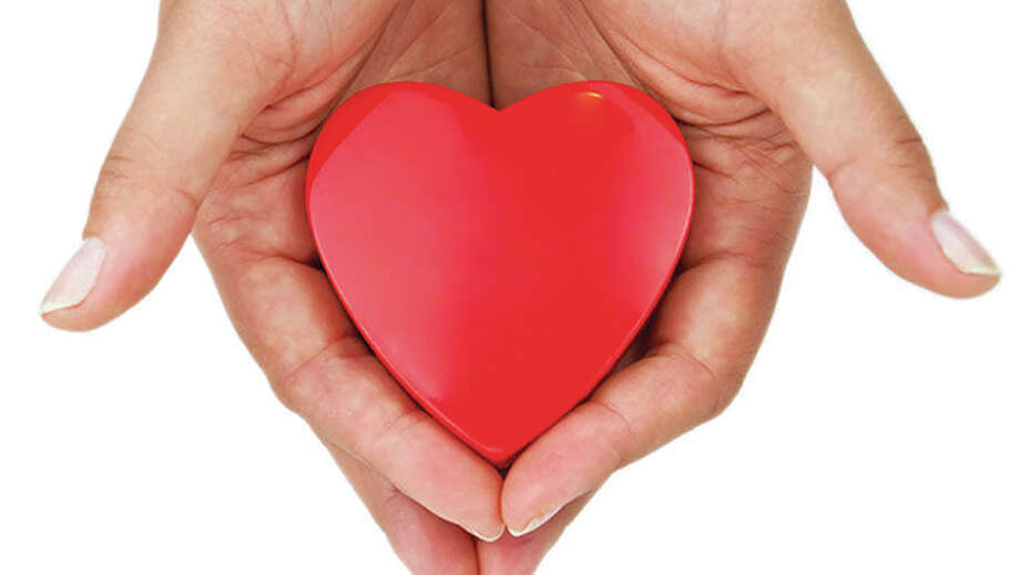 "The American Heart Association's ""Go Red For Women"" campaign works to increase awareness of heart disease in women. Photo: For The Telegraph"