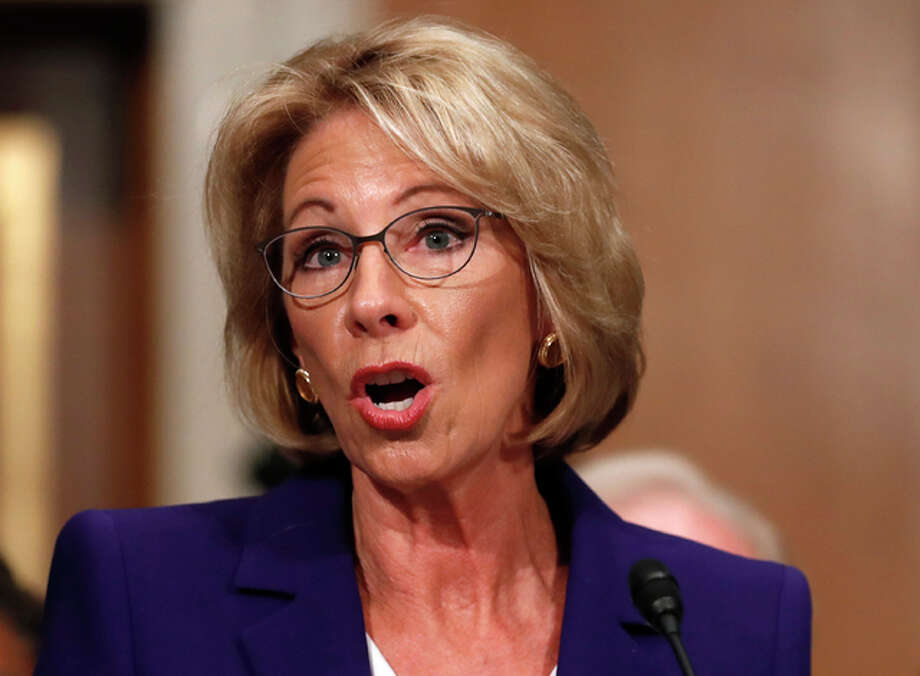FILE - In this Jan. 17, 2017 file photo, Education Secretary-designate Betsy DeVos testifies on Capitol Hill in Washington at her confirmation hearing before the Senate Health, Education, Labor and Pensions Committee.
