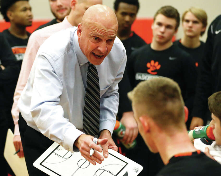 Edwardsville coach Mike Waldo gives instructions to his team during a timeout in a Southwestern Conference game against the Alton Redbirds on Jan. 24 at Alton High in Godfrey. Waldo, in his 29th season with the Tigers after five seasons at Marquette Catholic, picked up career victory No. 700 on Tuesday night at Lucco-Jackson Gym in Edwardsville. Photo: Billy Hurst / For The Telegraph