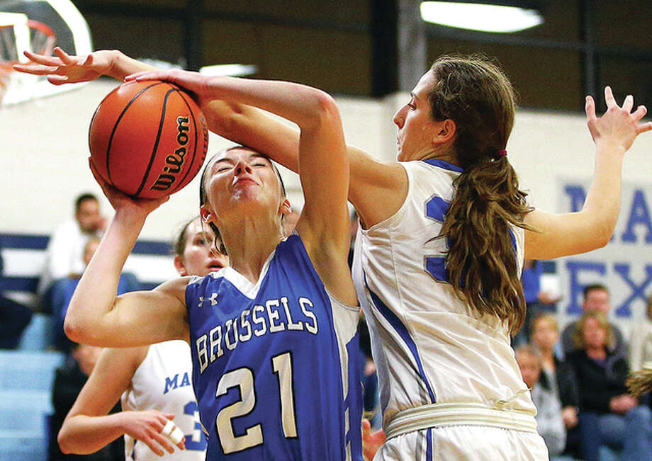 Brussels junior Baylee Kiel, left, scored 16 points in her team's 46-40 victory over Carrollton Tuesday night in the Greenfield Class 1A Regional. Photo: Billy Hurst File Photo | For The Telegraph