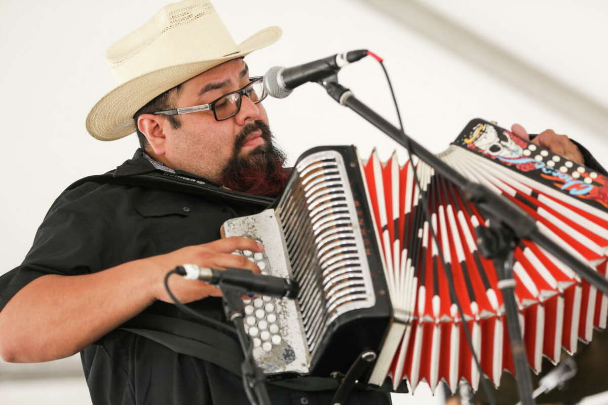 Roberto Rodriguez III plays accordion with Nick Gaitan and The Umbrella Man during the Conroe Americana Music Festival on Sunday, May 7, 2017, in downtown Conroe.