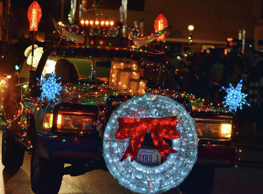 Jacksonville businesses and community members decorated floats and vehicle for the Santa Parade Friday.