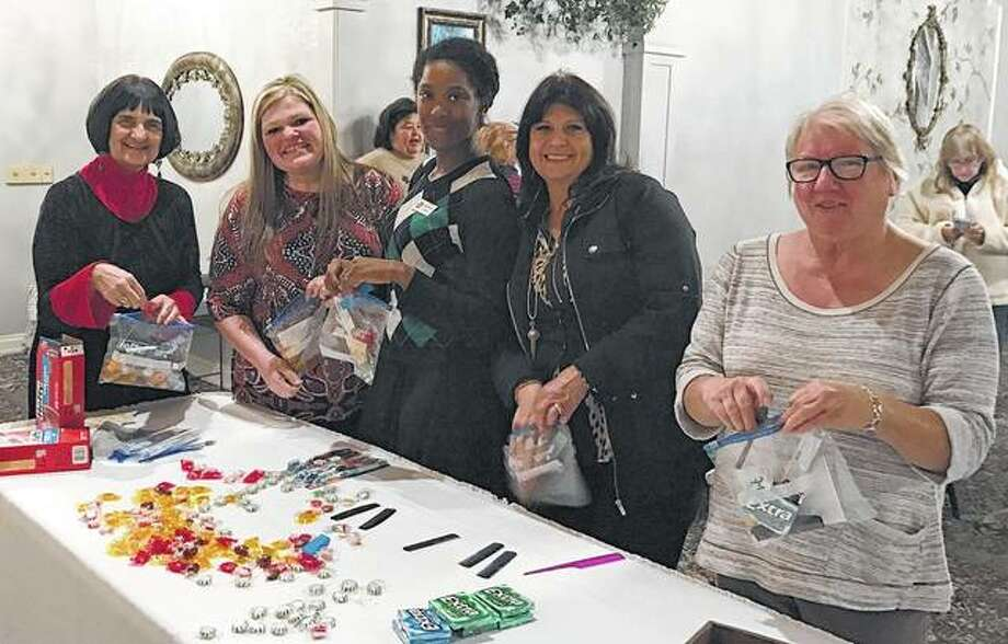 "Pilot Club members used part of their November membership meeting to prepare 37 small care packages for Drew Geer and his soldiers, who are deployed overseas until July. Among members participating in the service project were Karla Henderson (from left), Tiffanee Peters, Erika Wade-Smith, Caron Yates and Martha Hauck. Geer is the brother-in-law of club President Shelle Allen. Each package included a hand-written ""Thank You"" note from club members to the soliders. Photo: Photo Submitted"