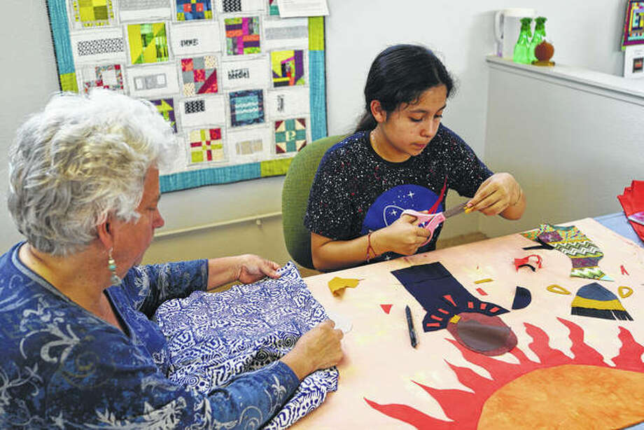 Yesenia Madrid works on a social justice art quilt with the help of Social Justice Sewing Academy volunteer Lynn Hickman at Bay Quilts in Richmond, California. Photo: Social Justice Sewing Academy Via Associated Press