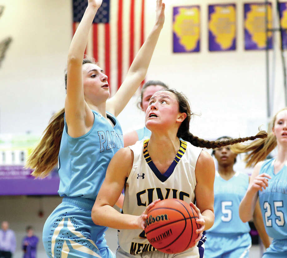 Civic Memorial's Allie Troeckler, right, looks to get off a shot as she is defended by Jersey's Mackenzie Thurston during Wednesday night's game in Bethalto. Photo: Bily Hurst | For The Telegraph
