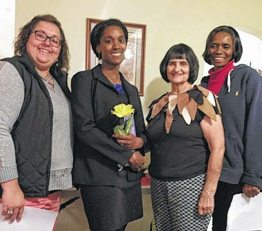 Pilot Club of Jacksonville had an initiation ceremony during its October meeting for new member Erika Wade-Smith (second from left). The club played host for its governor-elect, Jackie Turner (right) of Pilot Club of Galesburg, during the meeting, and she was able to participate in the ceremony. Club President Shelle Allen (left) and Wade-Smith's sponsor, Karla Henderson, welcomed Wade-Smith to the club. Photo: Photo Submitted