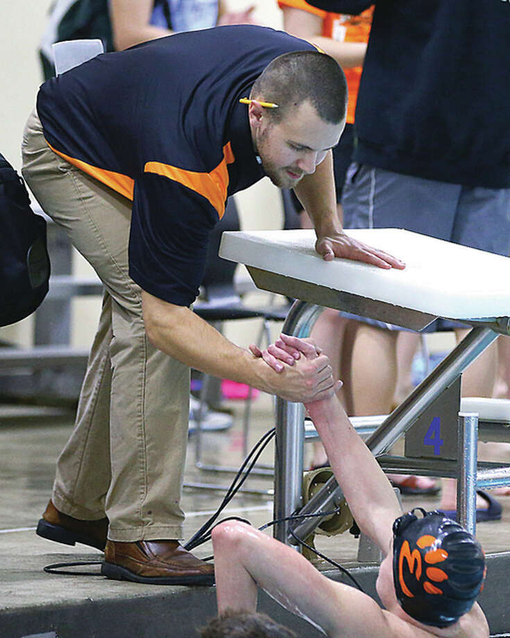 Edwardsville swim coach Christian Rhoten congratulates Brian Baggette after an earlier 500-yard freestyle win at the Chuck Fruit Aquatic Center at EHS. Baggette, last year's Telegraph Swimmer of the Year, posted a first-place finish in the event at Thursday's Southern Illinois High School Championships at EHS. Photo: Billy Hurst File Photo | For The Telegraph