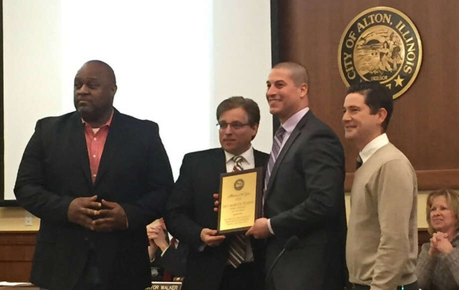 Alton Police Det. Marcos Pulido, center right, with Alton Mayor Brant Walker and members of the Alton Community Relations Commission after receiving the inaugural Public Servant of the Year award handed out by the city.