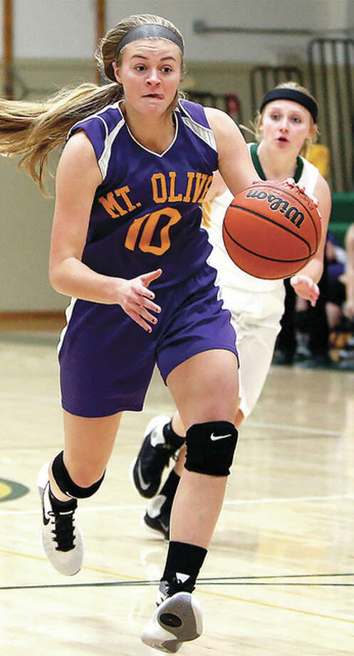 Mount Olive's Jill Niehaus (10) scored eight points in her team's loss to Okawville Thursday night. Photo: Telegraph File Photo