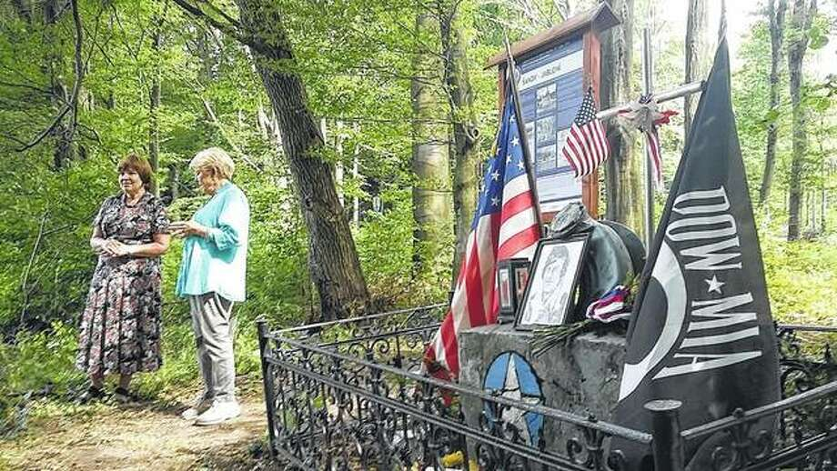Jane Pifer of San Antonio, Texas, daughter of 2nd Lt. Dick Hartman, a Jacksonville native killed during World War II, speaks in August at a monument near Sanov, Czech Republic, where Hartman's B-17 bomber crashed in 1944. Photo: Photo Courtesy Of Roman Susil