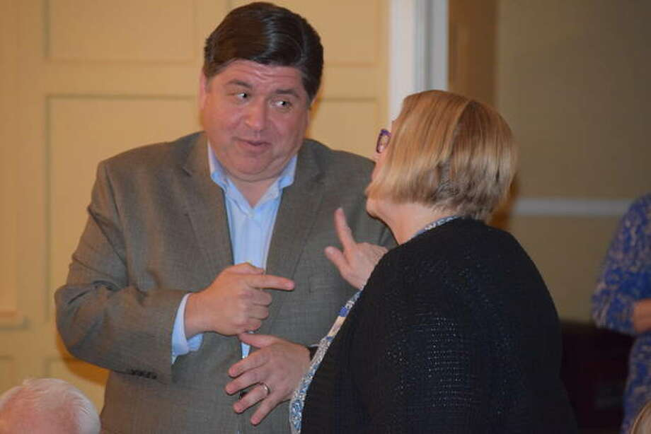Gubernatorial candidate J.B. Pritzker talks with Nancy Forsberg of Jacksonville at the Morgan County Democrats candidate event Monday. Photo: Nick Draper | Journal-Courier