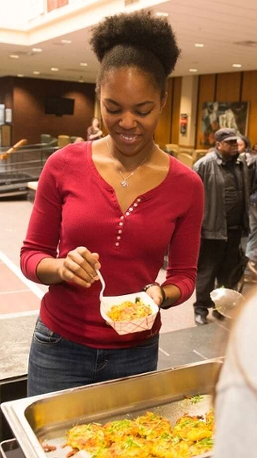 "For The Telegraph Erin Johnson, sophomore majoring in exercise science, samples some food at ""Taste of Culture: Africa."""